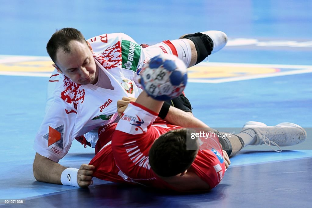 Maxim Babichev (UP) of Belarus vies for the ball with Lukas Herburger of Austria during the preliminary round group B match of the Men's 2018 EHF European Handball Championship between Belarus and Austria in Porec, Croatia on January 12, 2018. /