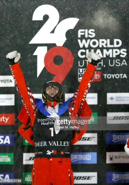 Maxim Burov of Russia in first place celebrates on the podium during the Men's Aerials Final at the FIS Freestyle Ski World Championships on February...