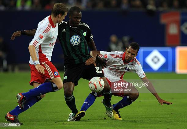 Maxim Choupo Moting of Hamburg and Grafite of Wolfsburg battle for the ball during the Bundesliga match between Hamburger SV and VFL Wolfsburg at...