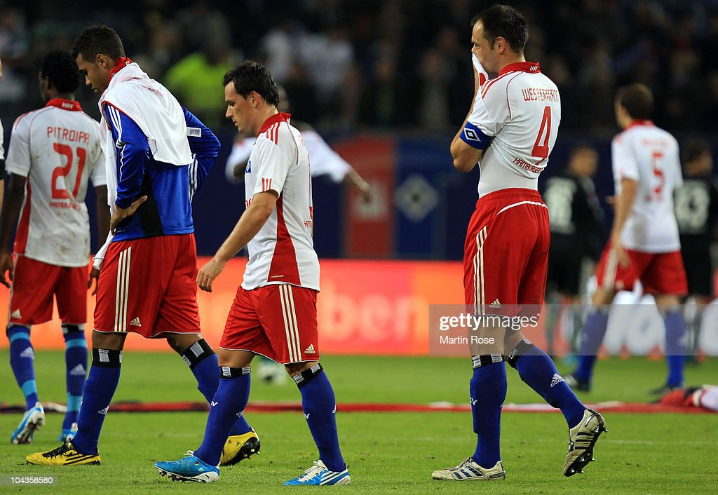 Maxim Choupo Moting, Piotr Trochowski and Heiko Westermann of Hamburg look dejected after the Bundesliga match between Hamburger SV and VFL Wolfsburg at Imtech Arena on September 22, 2010 in Hamburg, Germany.