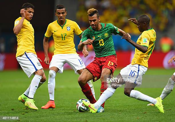Maxim ChoupoMoting of Cameroon is challenged by Thiago Silva Luiz Gustavo and Ramires of Brazil during the 2014 FIFA World Cup Brazil Group A match...