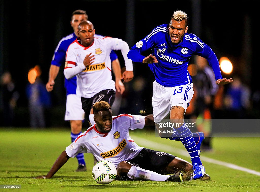 Maxim Choupo-Moting #13 of FC Schalke 04 is chased down by Gabriel Rodrigues dos Santos #77 and Gale Agbossoumonde #44 of the Fort Lauderdale Strikers during the match at the ESPN Wide World of Sports Complex on January 10, 2016 in Kissimmee, Florida.