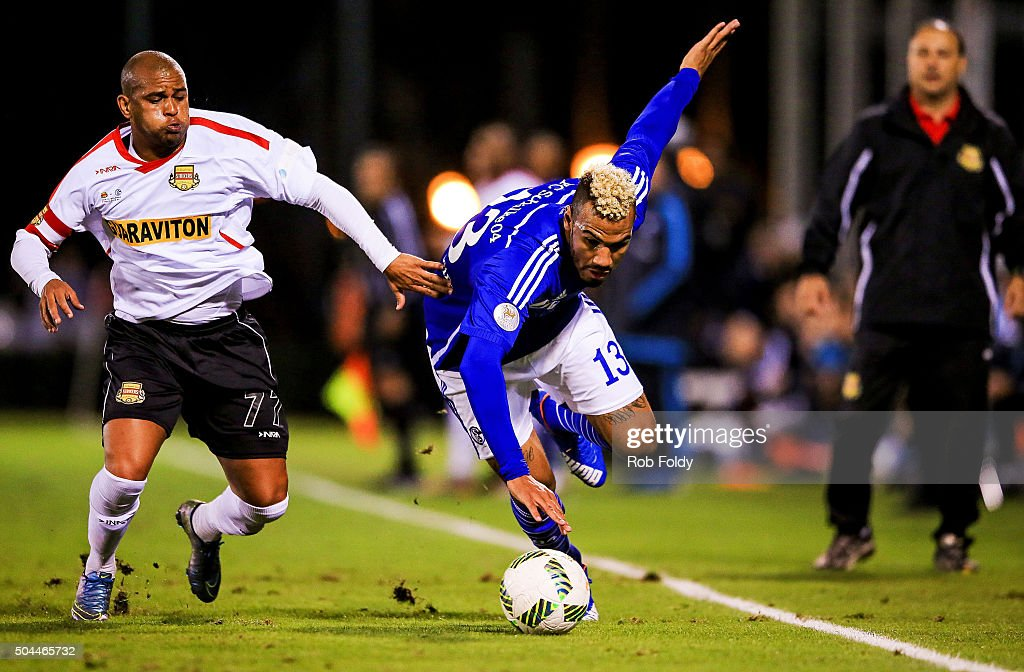 Maxim Choupo-Moting #13 of FC Schalke 04 is defended by Gabriel Rodrigues dos Santos #77 of the Fort Lauderdale Strikers during the match at the ESPN Wide World of Sports Complex on January 10, 2016 in Kissimmee, Florida.