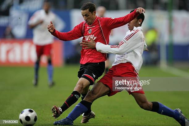 Maxim Choupo-Moting of Hamburg fights for the ball with Steven Cherundolo of Hannover during the Bundesliga match between Hamburger SV and Hannover...
