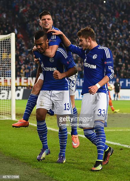 Maxim ChoupoMoting of Schalke celebrates scoring their fourth goal with Klaas Jan Huntelaar and Roman Neustaedter of Schalke during the UEFA...