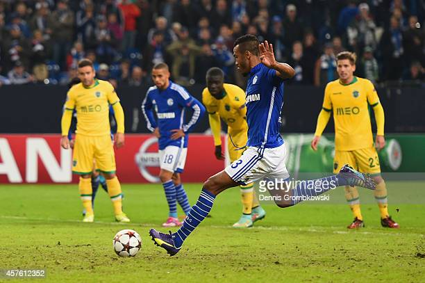Maxim Choupo-Moting of Schalke scores their fourth goal from the penalty spot during the UEFA Champions League Group G match between FC Schalke 04...
