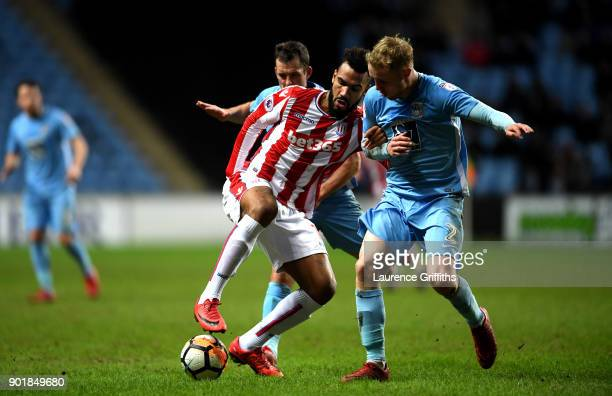 Maxim ChoupoMoting of Stoke City and Michael Doyle of Coventry City and Jack Grimmer of Coventry City in action during the The Emirates FA Cup Third...