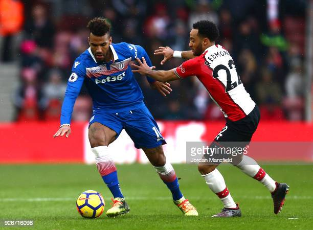 Maxim ChoupoMoting of Stoke City and Nathan Redmond of Southampton battle for the ball during the Premier League match between Southampton and Stoke...