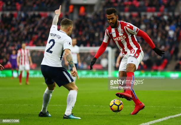 Maxim ChoupoMoting of Stoke City attempts to get past Kieran Trippier of Tottenham Hotspur during the Premier League match between Tottenham Hotspur...