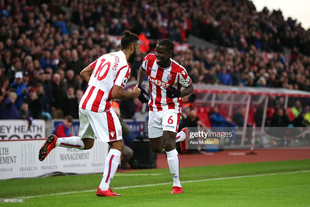 Maxim Choupo-Moting of Stoke City celebrates after scoring his sides second goal with Kurt Zouma of Stoke City during the Premier League match between Stoke City and West Bromwich Albion at Bet365 Stadium on December 23, 2017 in Stoke on Trent, England.