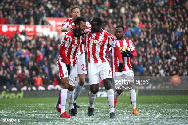 Maxim ChoupoMoting of Stoke City celebrates scoring his side's first goal with team mates during the Premier League match between Stoke City and...