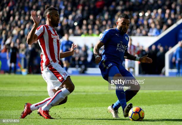 Maxim ChoupoMoting of Stoke City chases down Danny Simpson of Leiceter City during the Premier League match between Leicester City and Stoke City at...