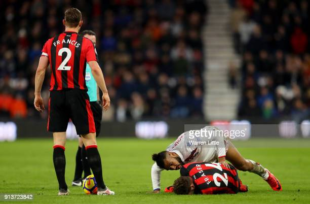 Maxim ChoupoMoting of Stoke City checks if Ryan Fraser of AFC Bournemouth is ok during the Premier League match between AFC Bournemouth and Stoke...