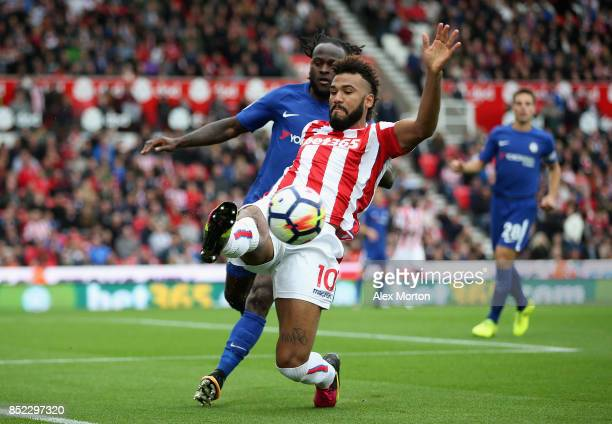 Maxim ChoupoMoting of Stoke City controls the ball under pressure of Victor Moses of Chelsea during the Premier League match between Stoke City and...