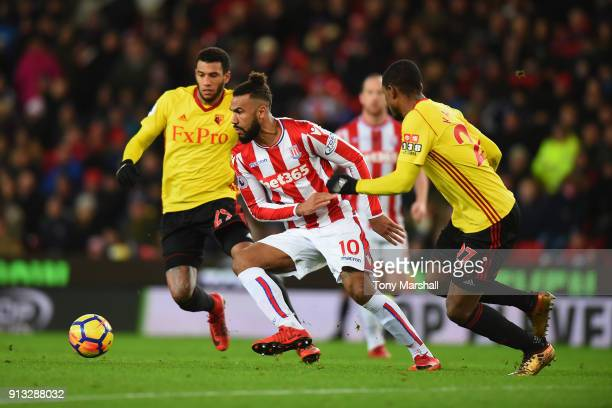 Maxim ChoupoMoting of Stoke City gets between Etienne Capoue and Christian Kabasele of Watford during the Premier League match between Stoke City and...