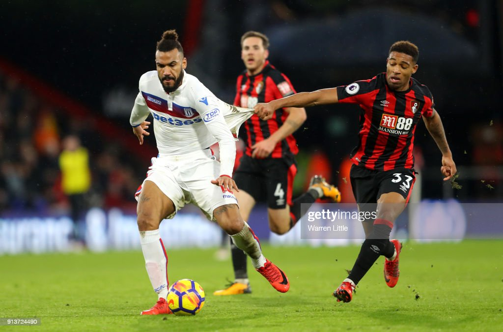 Maxim Choupo-Moting of Stoke City is challenged by Jordon Ibe of AFC Bournemouth during the Premier League match between AFC Bournemouth and Stoke City at Vitality Stadium on February 3, 2018 in Bournemouth, England.