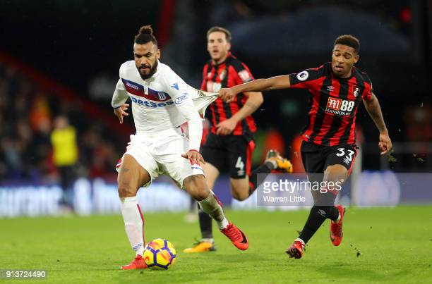 Maxim Choupo-Moting of Stoke City is challenged by Jordon Ibe of AFC Bournemouth during the Premier League match between AFC Bournemouth and Stoke...