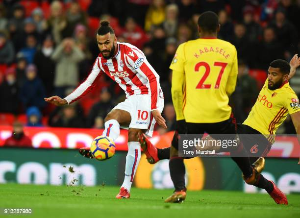 Maxim ChoupoMoting of Stoke City is tackled by Adrian Mariappa of Watford during the Premier League match between Stoke City and Watford at Bet365...