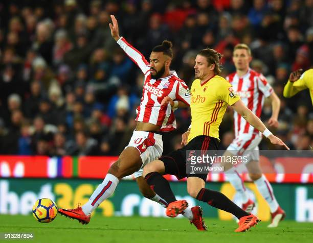 Maxim ChoupoMoting of Stoke City is tackled by Sebastian Prodl of Watford during the Premier League match between Stoke City and Watford at Bet365...