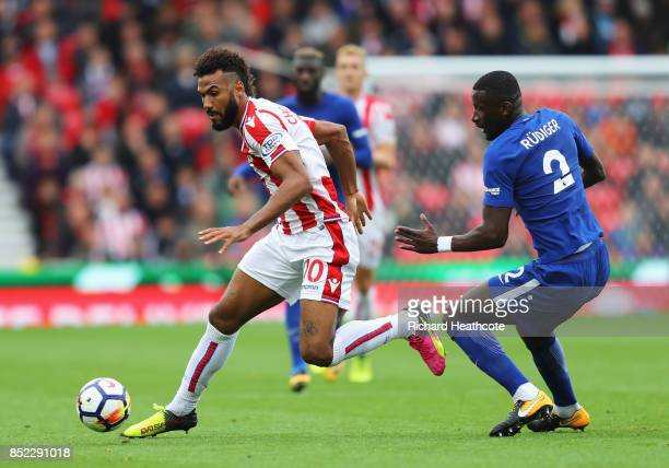 Maxim ChoupoMoting of Stoke City runs past Antonio Rudiger of Chelsea during the Premier League match between Stoke City and Chelsea at Bet365...