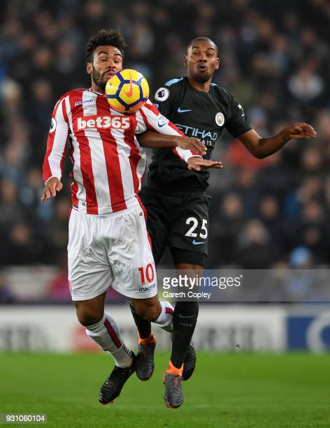 Maxim ChoupoMoting of Stoke City shields the ball from Fernandinho of Manchester City during the Premier League match between Stoke City and...