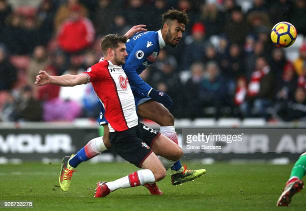 Maxim ChoupoMoting of Stoke City shoots and misses as he is chased by Jack Stephens of Southampton during the Premier League match between...