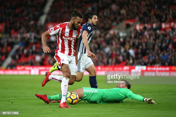 Maxim ChoupoMoting of Stoke City takes the ball round Ben Foster of West Bromwich Albion and goes on to score his sides second goal during the...