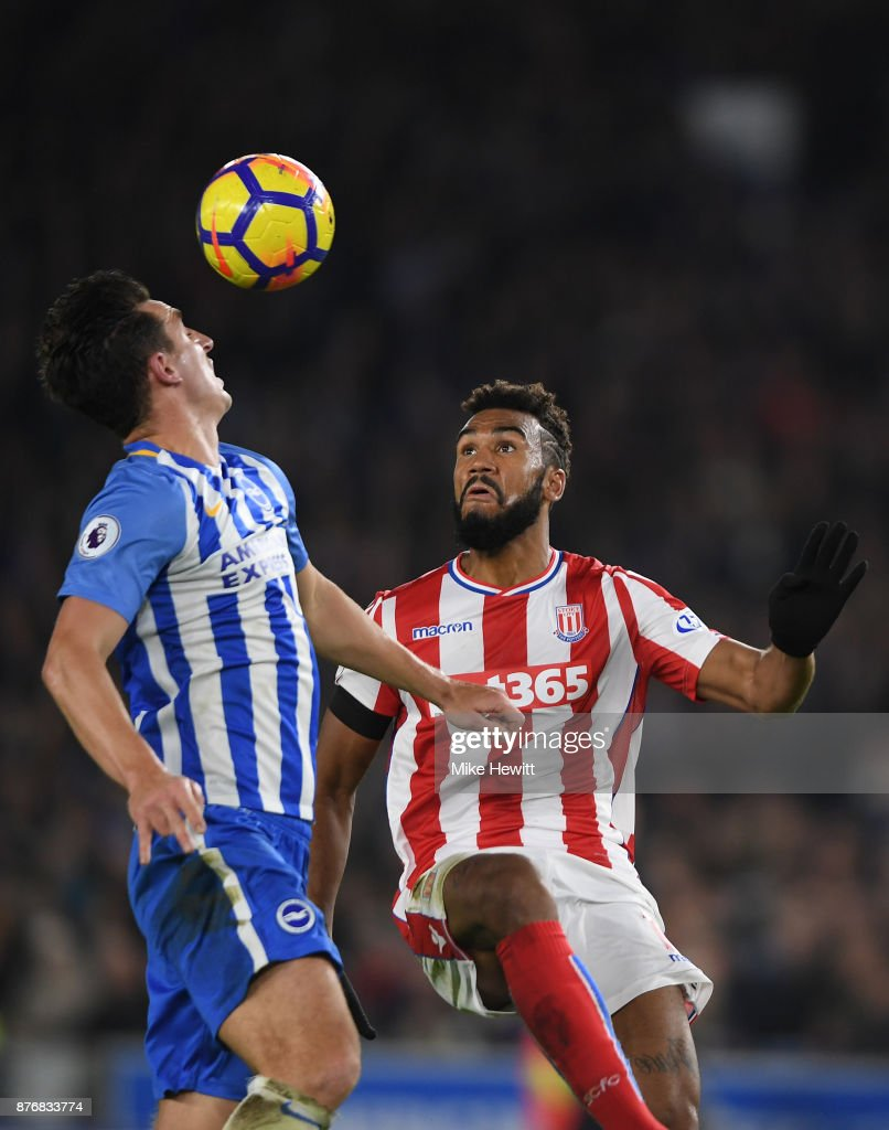 Maxim Choupo-Moting of Stoke is challenged by Lewis Dunk of Brighton during the Premier League match between Brighton and Hove Albion and Stoke City at Amex Stadium on November 20, 2017 in Brighton, England.