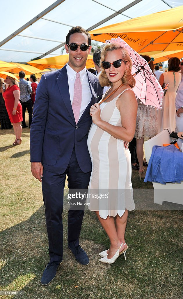 Maxim Crewe and Charlotte Dellal attend the Veuve Clicquot Gold Cup final at Cowdray Park Polo Club on July 21, 2013 in Midhurst, England.