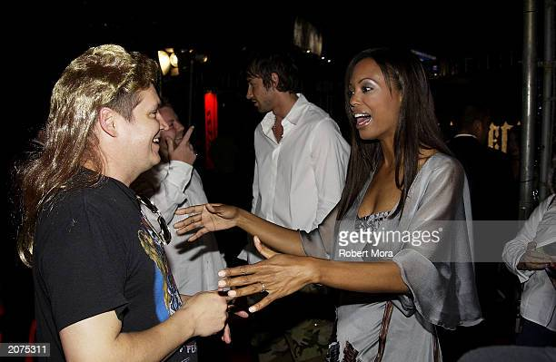 Maxim EditorinChief Keith Blanchard and actress Aisha Tyler attend Maxim's Hot 100 party on June 11 2003 in Hollywood California