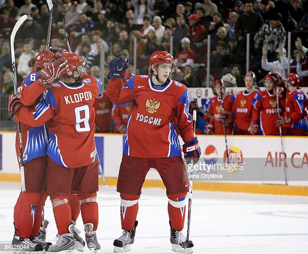Maxim Goncharov of Russia celebrates his goal with his team mates Dmitri Klopov and Mikhail Pashnin against Latvia at the Civic Centre on December...