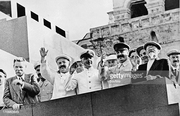 Maxim gorky vyacheslav molotov k voroshilov joseph stalin mikhail kalinin and nikolai bulganin on the platform of the lenin mausoleum during a sports...
