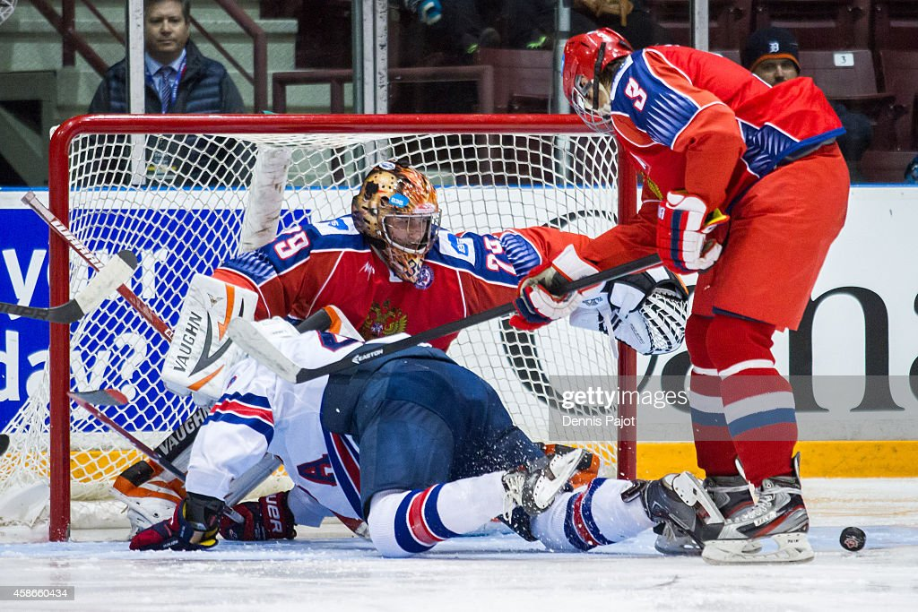 Maxim Kalyayev #29 of Russia makes a huge save against the United States during the gold medal game at the World Under-17 Hockey Challenge on November 8, 2014 at the RBC Centre in Sarnia, Ontario, Canada.