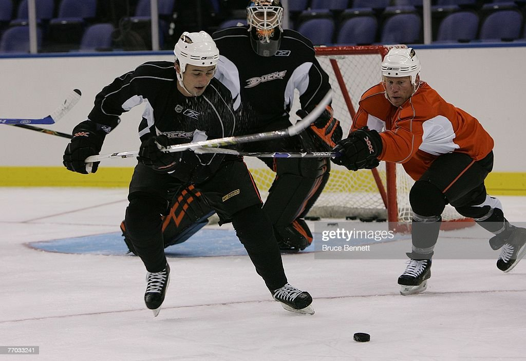 Maxim Kondratiev of the Anaheim Ducks is pursued by Todd Marchant during practice on September 26, 2007 at the O2 arena in London, England.