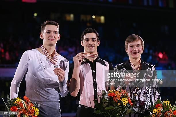 Maxim Kovtun of Russia Javier Fernandez of Spain and Mikhail Kolyada of Russia pose in the Men's medal ceremony during day 4 of the European Figure...