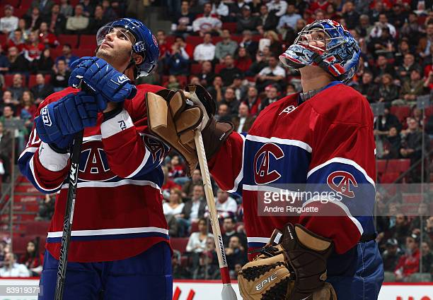Maxim Lapierre and Carey Price of the Montreal Canadiens watch a video presentation prior to a game against the New York Rangers on a night honoring...