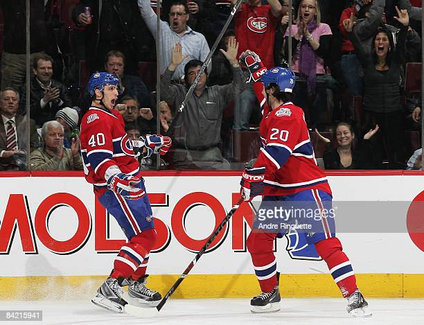 Maxim Lapierre and Robert Lang of the Montreal Canadiens celebrate a first period goal against the Toronto Maple Leafs at the Bell Centre on January...