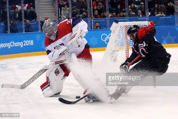 Maxim Lapierre of Canada skates against Pavel Francouz of the Czech Republic in the first period during the Men's Ice Hockey Preliminary Round Group...