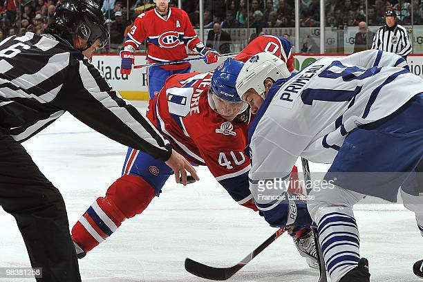 Maxim Lapierre of Montreal Canadiens facs off with Wayne Primeau of the Toronto Maple Leafs during the NHL game on April 10 2010 at the Bell Center...