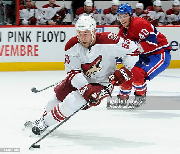 Maxim Lapierre of the Montreal Canadiens chases Derek Morris of the Phoenix Coyotes during the NHL game on October 25 2010 at the Bell Centre in...