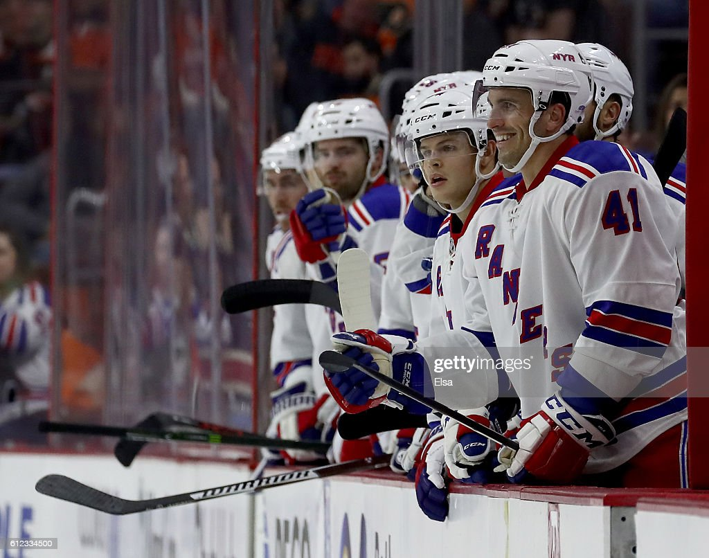 Maxim Lapierre #41 of the New York Rangers celebrates with teammates on the bench after Jimmy Vesey of the Rangers scored a goal to tie the game in the third period against Philadelphia Flyers during a preseason game on October 3, 2016 at Wells Fargo Center in Philadelphia, Pennsylvania.