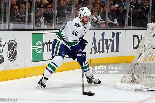 Maxim Lapierre of the Vancouver Canucks skates with the puck against the Los Angeles Kings in Game Four of the Western Conference Quarterfinals...