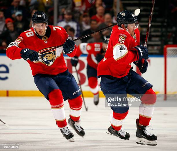 Maxim Mamin and MacKenzie Weegar of the Florida Panthers skate for position against the Montreal Canadiens at the BBT Center on March 8 2018 in...