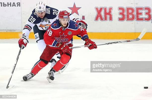 Maxim Mamin of CSKA and Denis Platonov of Metallurg in action during a match between PHC CSKA HC Metallurg in the playoff finals of the Kontinental...