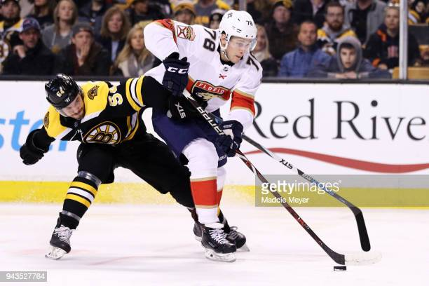 Maxim Mamin of the Florida Panthers and Adam McQuaid of the Boston Bruins battle for control of the puck during the second period at TD Garden on...