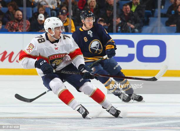 Maxim Mamin of the Florida Panthers and Casey Nelson of the Buffalo Sabres follow the play during an NHL game on February 1 2018 at KeyBank Center in...