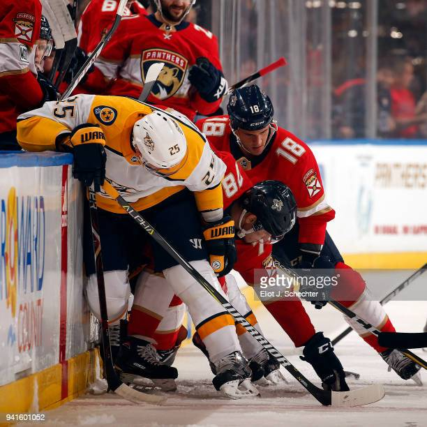 Maxim Mamin of the Florida Panthers and teammate Micheal Haley battle for the puck against Alexei Emelin of the Nashville Predators at the BBT Center...