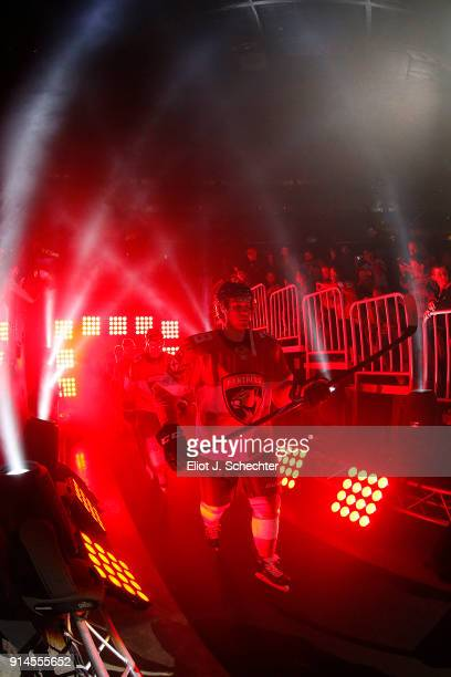 Maxim Mamin of the Florida Panthers and teammates head out to the ice for introductions prior to the start of their game against the Detroit Red...