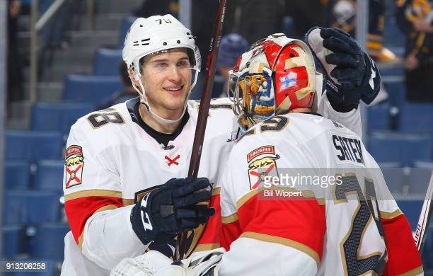 Maxim Mamin of the Florida Panthers congratulates Harri Sateri after their 42 victory against the Buffalo Sabres during an NHL game on February 1...