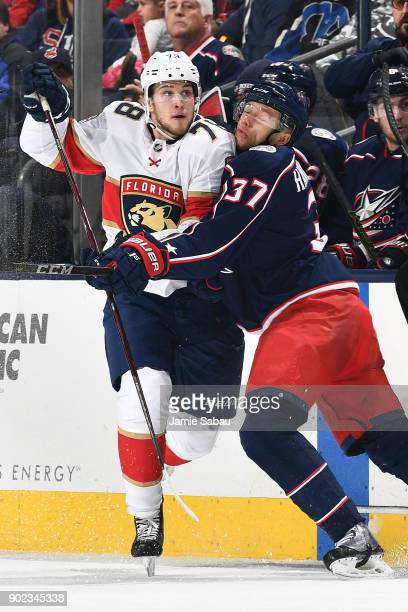 Maxim Mamin of the Florida Panthers is checked by Markus Hannikainen of the Columbus Blue Jackets in the second period on January 7 2018 at...